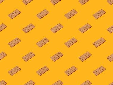 Fresh crispbread on orange colorful background, seamless pattern stock vector