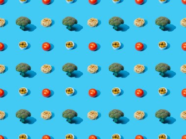 Fresh pasta with broccoli, olives and tomatoes on blue background, seamless pattern stock vector
