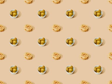 Fresh pasta with olives on beige background, seamless pattern stock vector