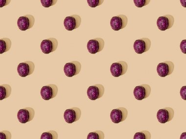 Top view of whole ripe red cabbage on beige background, seamless pattern stock vector