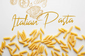 Top view of uncooked penne on white background, italian pasta illustration
