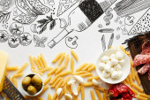 Fotografie Top view of pasta, meat platter, grater and ingredients on white background, food illustration