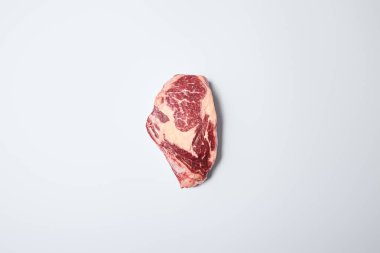 Top view of fresh raw steak on on white background stock vector
