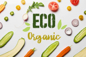 top view of fresh sliced vegetables on white background with eco organic illustration