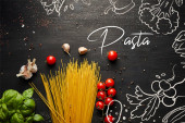 top view of raw bolognese pasta ingredients on black wooden background, pasta illustration