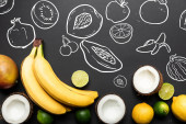 top view of ripe tropical fruits on black background with exotic fruits illustration