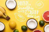 top view of citrus fruits, bananas and coconuts on yellow background, drink smoothie every day keep doctor away illustration