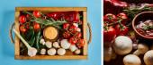 koláž lahodných omáček v miskách v blízkosti čerstvé zralé zeleniny, rozmarýnu a hub v dřevěné krabici na modrém pozadí