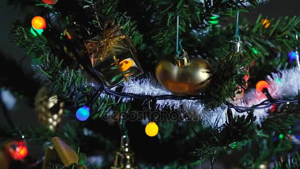 Artificial Christmas Tree Dressed With Fairy Lights Travel Camera Upwards Close Up In Slow