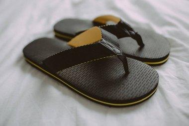 Black flip flops close up