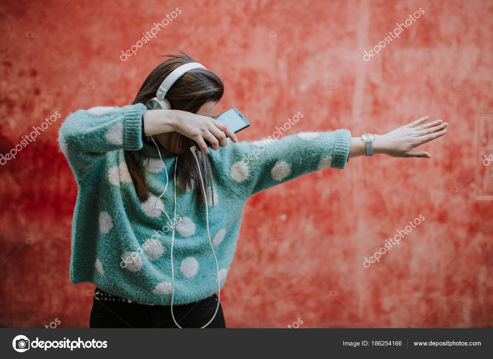 Woman Doing Dab Street Listening Music Her Headphones
