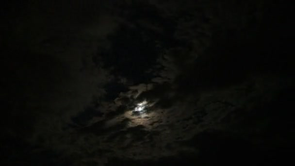 moon behind cloud silhouettes