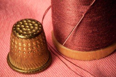 bobbin with thread and thimble