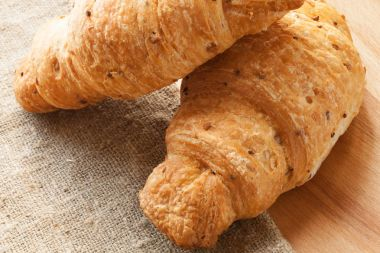 Croissants with sesame on table