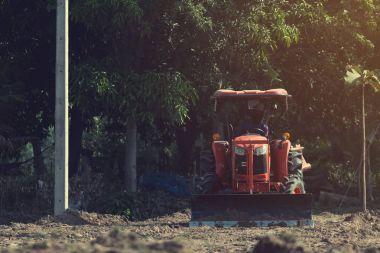 Grader leveling landfill on construction site before kick off pr