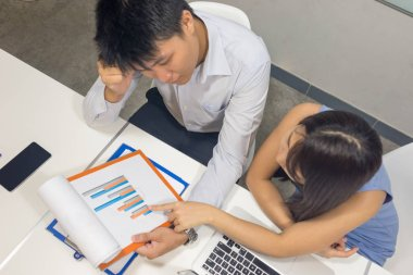 Asian business people discuss about financial document