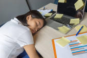 Young office woman tired with many financial problem