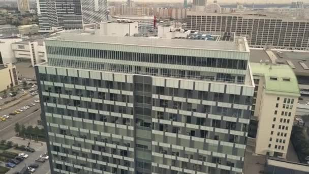 Business office building on background residential apartment in city aerial view