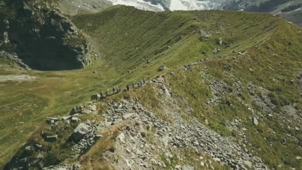 Drone view hiking people traveling a mountain. Tourist group climbing a mountain