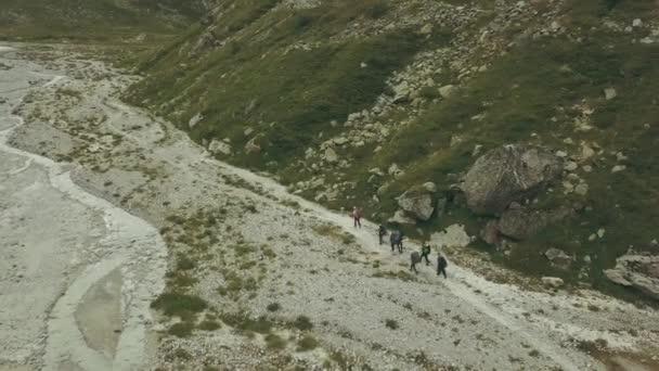 Tourist group hiking on mountain trail. Mountain tourism