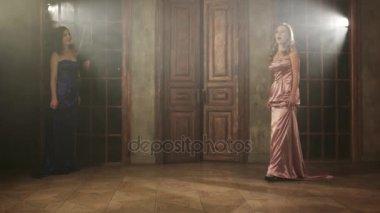 Two beautiful opera singers in long dresses
