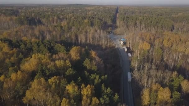 Aerial view truck car driving on highway road on background autumn nature