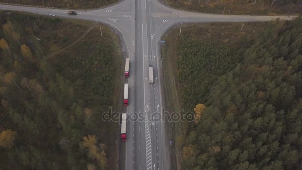 Aerial view truck car with freight container parking on roadsideat highway