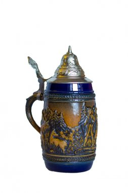 isolated traditional German metal beer mug with lid and handle with fleece painting and molding