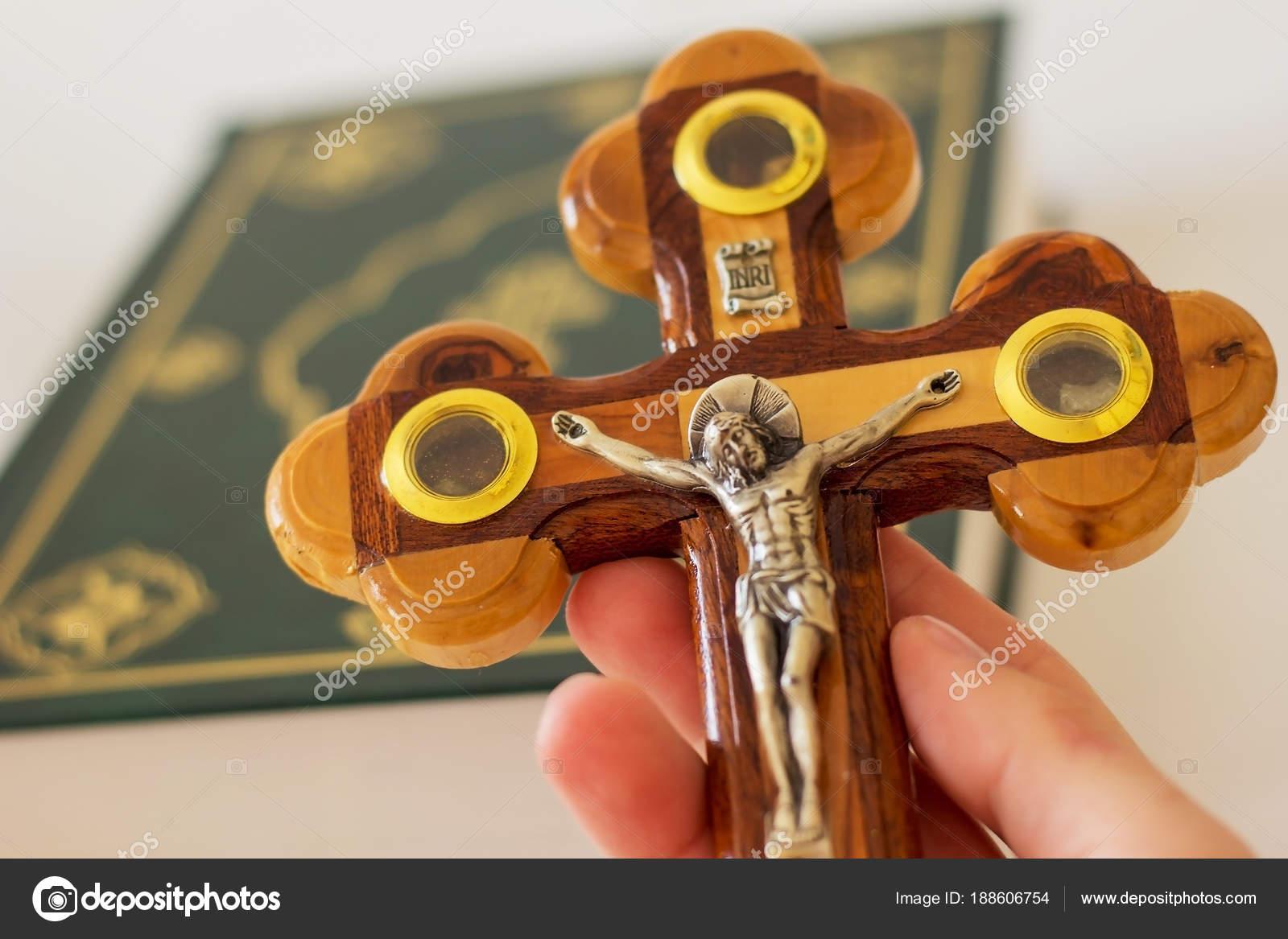 Hand Holding Cross Depicting Crucifixion Jesus Christ