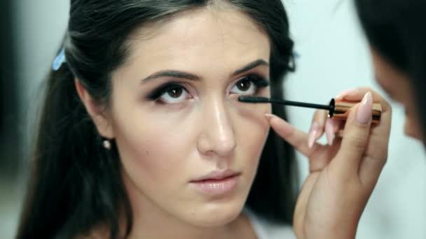 Make-up. Applying Mascara. Long Eyelashes