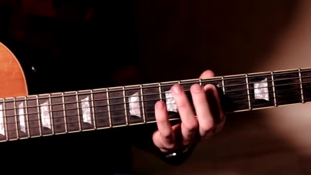 Professional Guitarist Playing Riffs On Electric Guitar At Home Studio. Close Up