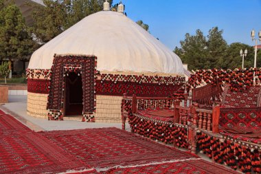 Ethnic nomadic yurt-building and trestle-bed, built for the cele
