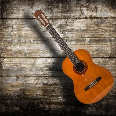 acustic guitar isolated in wooden background
