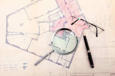 Cadastral map with glasses and pen
