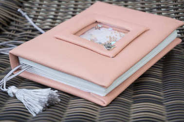 Handmade pink leather notebook with decoration like shaker with