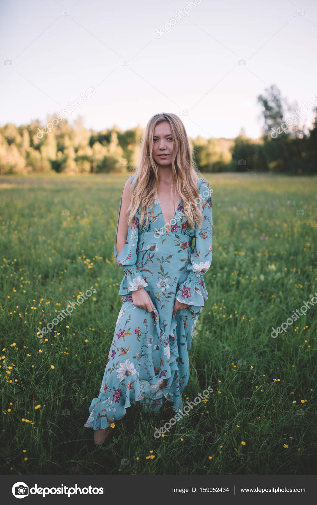 Hippie blonde hair girl in a colourful dress during her wedding day ...