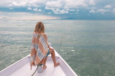 woman standing on bow of yacht