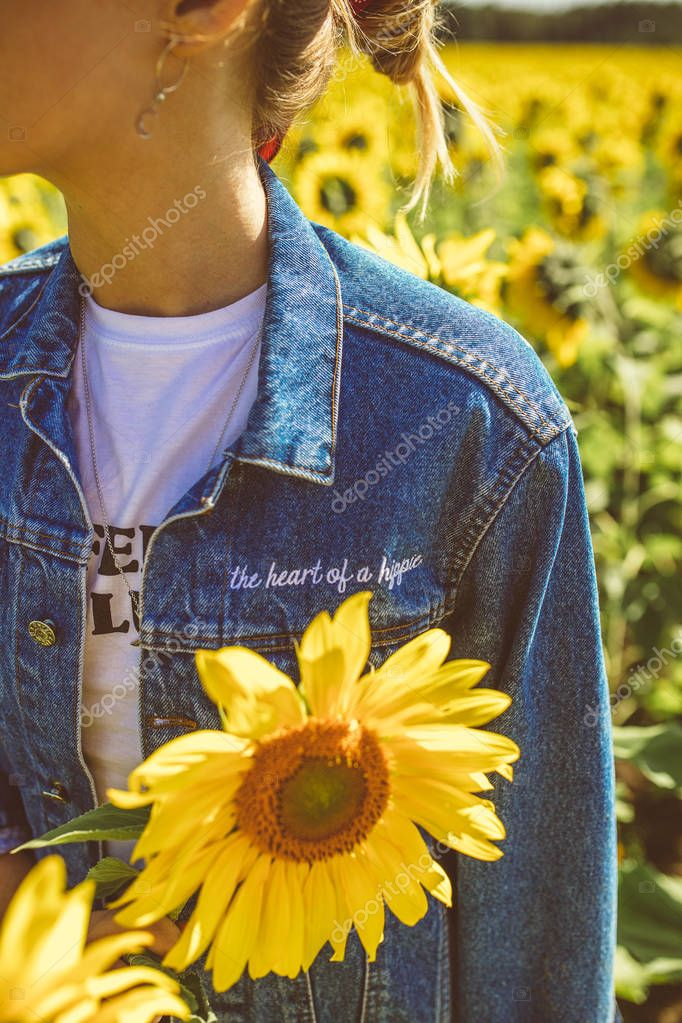 cropped portrait of young woman enjoying summer at sunflower field