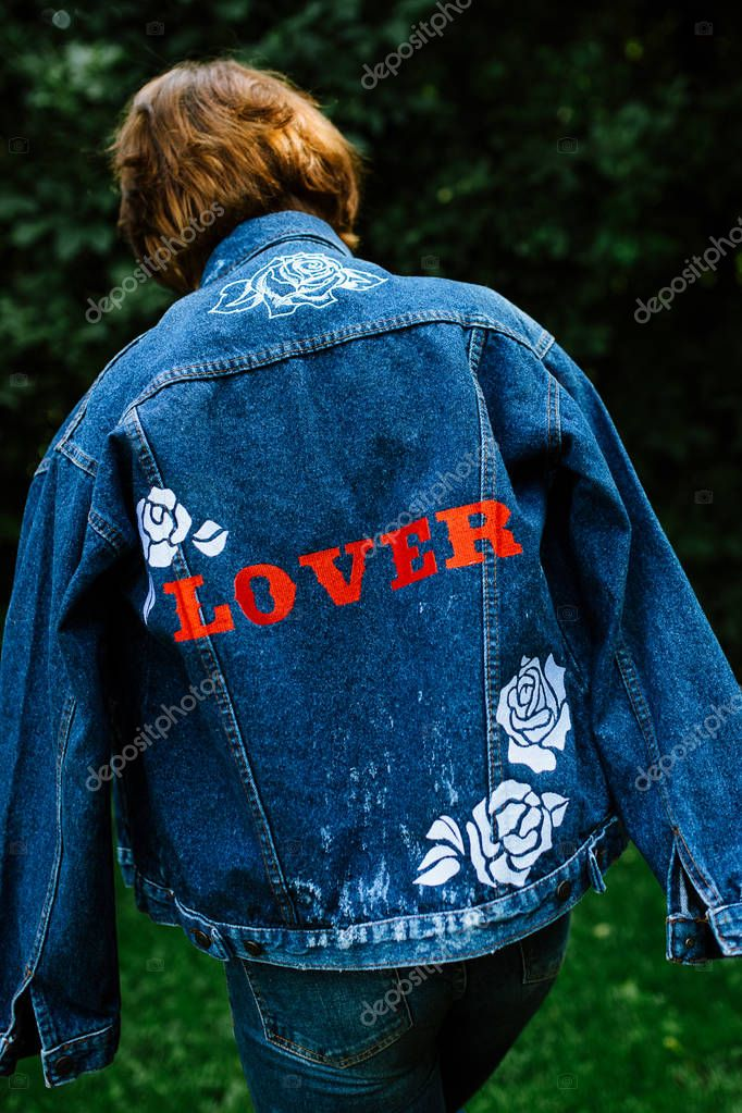 Girl enjoying the time in her garden in a denim jacket, hippie soul