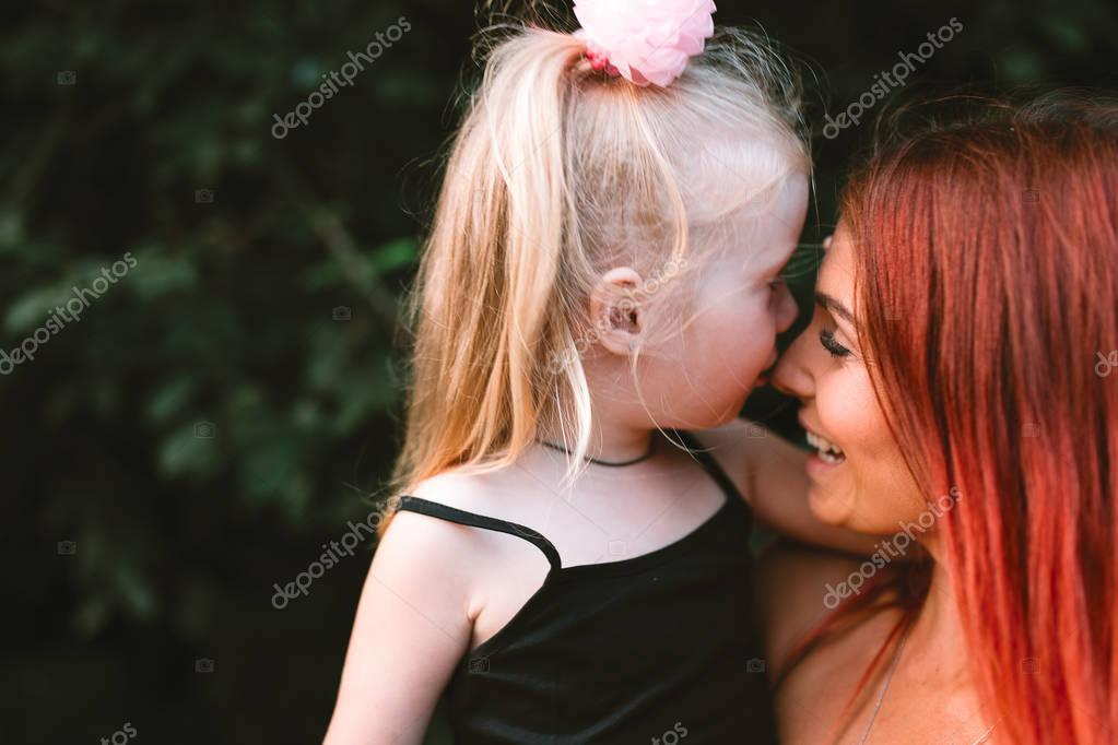Young mother and daughter together having joyful moment of being together