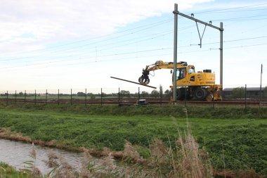 Maintenance on the railroadtracks between Gouda and Rotterdam at Nieuwerkerk aan den IJssel