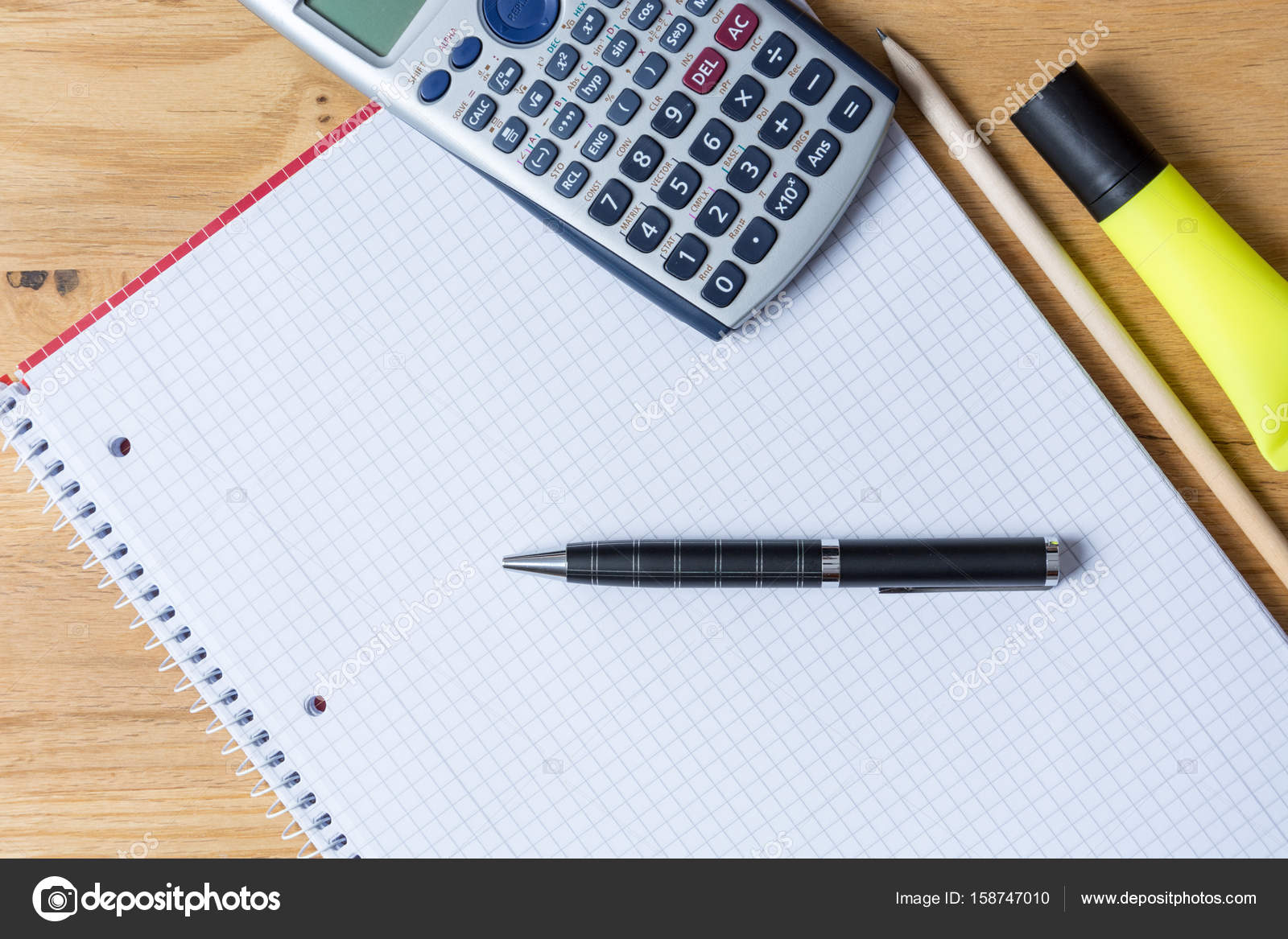 Work Desk With Note Pad Calculator And Biro On Wooden Table Stock Ballpoint Diagram Notepad Royalty Free Photos Photo