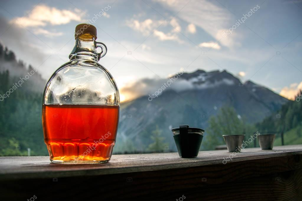 Drinking plum brandy after a long hiking tour in the mountains i