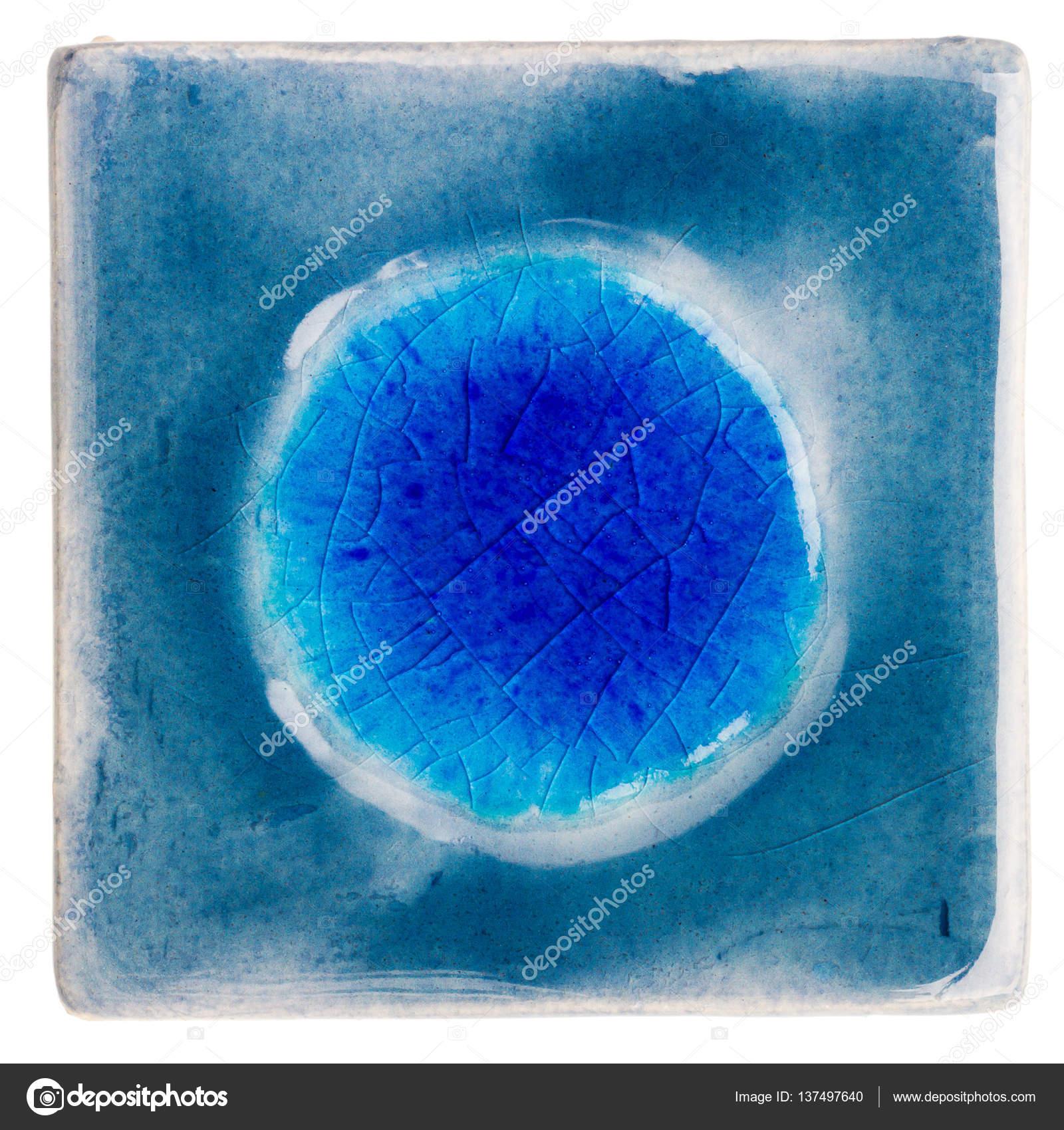 Handmade glazed ceramic tile stock photo taigi 137497640 blue handmade glazed ceramic tile with bubble in middle isolated on white photo by taigi dailygadgetfo Gallery