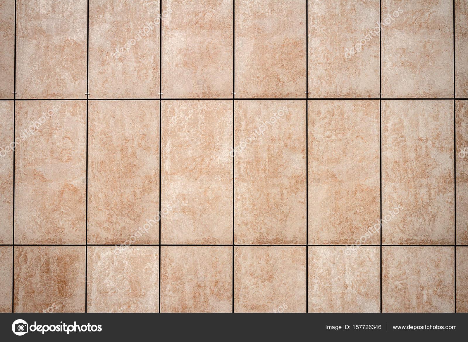 Fondo di struttura della parete di piastrelle beige chiaro u foto