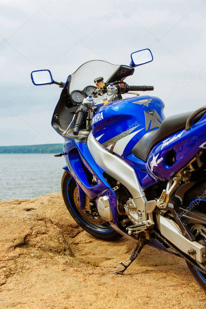 Vinnitsa, Ukraine - August 2017: Motorcycle blue Yamaha on a background of nature.