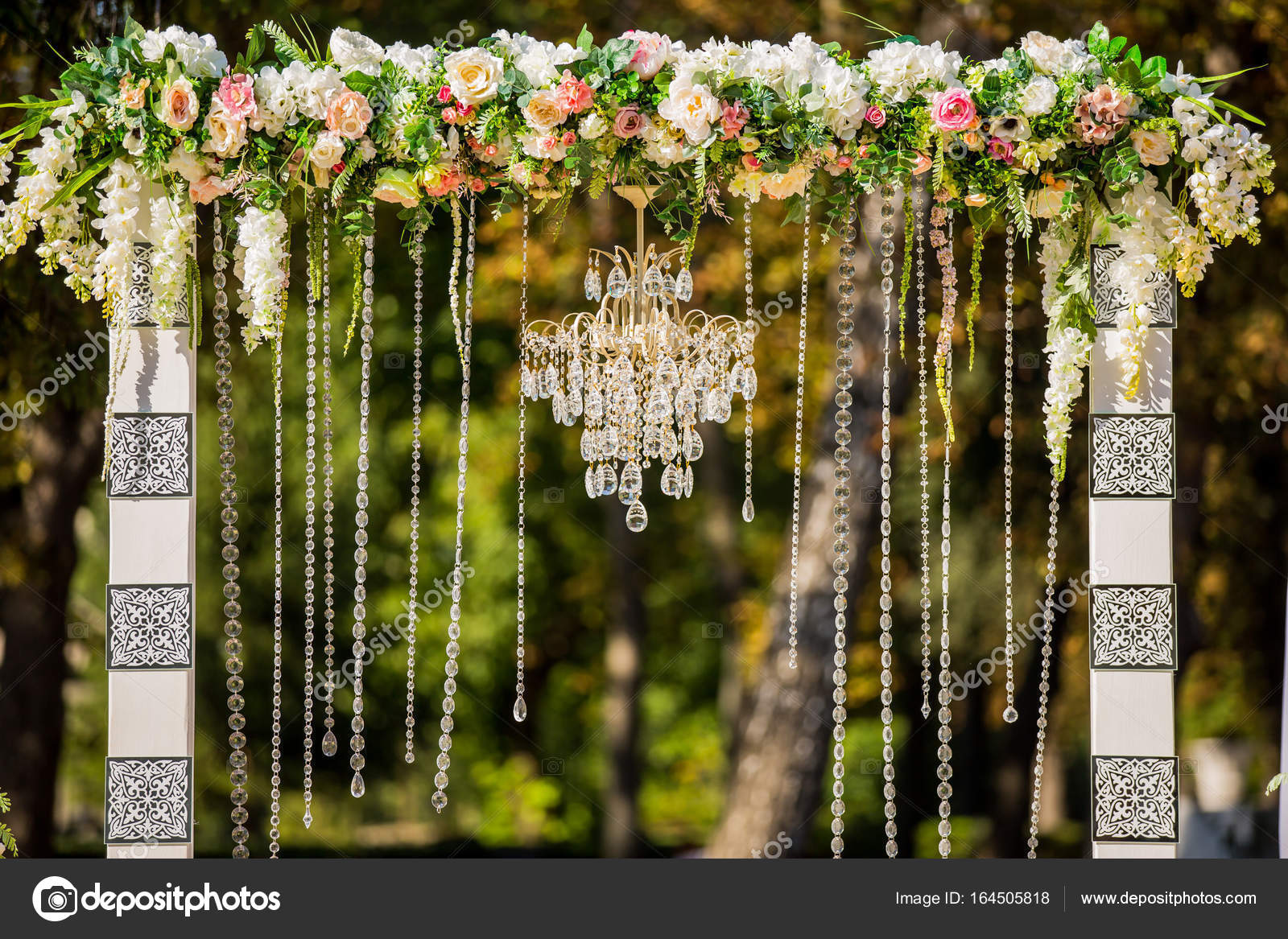 Arch for the wedding ceremony decorated with crystal chandelier and arch for the wedding ceremony decorated with crystal chandelier and fresh flowers wedding decorations the newlyweds photo by wedmov junglespirit Choice Image