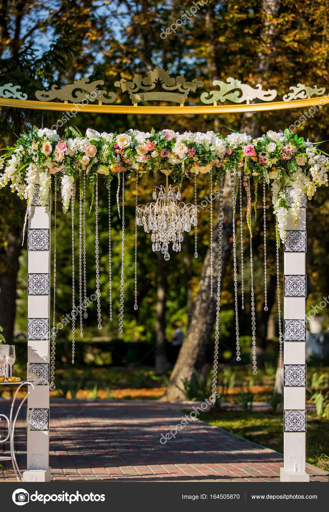 Arch For The Wedding Ceremony Decorated With Crystal Chandelier
