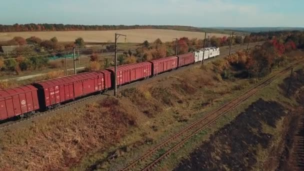 freight train with building materials is passing by rail to the destination. Aerial view