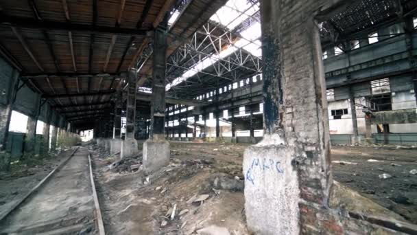 Abandoned and haunted industrial creepy warehouse inside. Old ruined factory building.